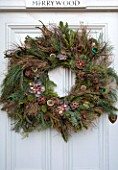 MERRYWOOD, JACKY HOBBS HOUSE, LONDON: NATURAL DOOR WREATH AND GARLAND. CONES, SEEDS, DECORATIONS, PEACOCK FEATHERS