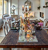 MERRYWOOD, JACKY HOBBS HOUSE, LONDON: SITTING ROOM - DINING AREA, WOODEN DINING TABLE AND CHAIRS, MIRRORS, CANDLES, METAL CROWNS