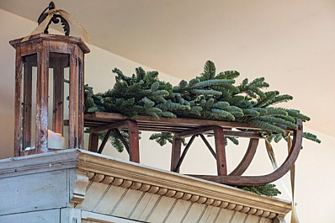MERRYWOOD_JACKY_HOBBS_HOUSE_LONDON_VINTAGE_WOODEN_SLEIGH_FIR_BOUGHS