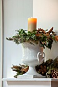 MERRYWOOD, JACKY HOBBS HOUSE, LONDON: DINING ROOM - WHITE FRENCH VINTAGE CERAMIC DECORATIVE URN, CONTAINER, CANDLE, PINE CONES, IVY