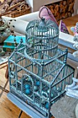 MERRYWOOD, JACKY HOBBS HOUSE, LONDON: DINING ROOM - CHRISTMAS DECORATION. BLUE BIRD CAGE