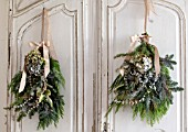 MERRYWOOD, JACKY HOBBS HOUSE, LONDON: WHITE KITCHEN, CHRISTMAS: VINTAGE FRENCH CUPBOARDS, PINE AND HYDRANGEA HANGING BOUQUETS