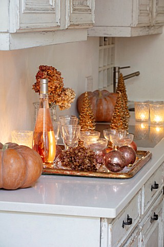 MERRYWOOD_JACKY_HOBBS_HOUSE_LONDON_WHITE_KITCHEN_CHRISTMAS_ORANGE_PUMPKINS_CANDLES_TRAY_BRONZE_AND_G