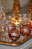 MERRYWOOD, JACKY HOBBS HOUSE, LONDON: WHITE KITCHEN, CHRISTMAS: CANDLES, TRAY, BRONZE AND GOLD DECORATIONS, CHAMPAGNE GLASSES