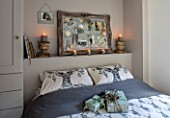 MERRYWOOD, JACKY HOBBS HOUSE, LONDON: GUEST BEDROOM IN GREY AND WHITE. PRINTED STAG PILLOWS, SILVER PIN BOARD, CANDLES