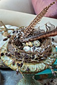 JACKY HOBBS HOUSE, LONDON: RUSTIC METAL VERDIGRIS URN, CONTAINER WITH BIRDS NEST AND QUAILS EGGS, PHEASANT FEATHERS