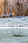 THE OLD RECTORY, QUINTON, NORTHAMPTONSHIRE: DESIGNER ANOUSHKA FEILER: METAL BIRD SCULPTURE ON LAWN, ORNAMENT, WINTER, FROST