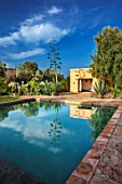 TAROUDANT, MOROCCO: DESIGNERS ARNAUD MAURIERES AND ERIC OSSART: PRIVATE GARDEN - SWIMMING POOL, TERRACE, CACTUS, APRIL, AFRICA