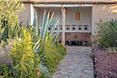 TAROUDANT, MOROCCO: DESIGNERS ARNAUD MAURIERES AND ERIC OSSART: PATH, CACTUS, CACTI, ARID, DRY, BORDERS, SEATING AREA