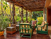 TAROUDANT, MOROCCO: DESIGNERS ARNAUD MAURIERES AND ERIC OSSART: PATIO, TERRACE, GREEN CHAIRS, SEATING, CANOPY, SHADE, SHADY, RELAXING, DECKING
