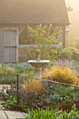 GRAVETYE MANOR SUSSEX: SPRING, APRIL, COUNTRY, GARDEN, PATH, SUMMERHOUSE, WATER FOUNTAIN