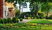 MORTON HALL, WORCESTERSHIRE: LAWN, BOX BALLS, TOPIARY, STATUES, STATUARY, SPRING, APRIL, EPIMEDIUM X VERSICOLOR SULPHUREUM