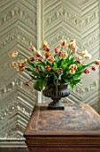 THE LAND GARDENERS, WARDINGTON MANOR, OXFORDSHIRE: TULIPS ARRANGED IN METAL CONTAINER ON WOODEN TABLE. SPRING, ARRANGEMENT, CUTTING