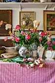 THE LAND GARDENERS, WARDINGTON MANOR, OXFORDSHIRE: TULIPS IN VASES IN THE FLOWER ROOM. SPRING, ARRANGEMENTS