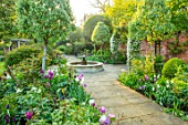 MORTON HALL, WORCESTERSHIRE: TULIPS IN THE SOUTH GARDEN, PATHS, FOUNTAIN, WATER, FEATURE, SPRING, APRIL