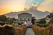 RADICEPURA GARDEN FESTIVAL, SICILY, ITALY: LONG WALKWAY WITH ETNA IN THE BACKGROUND AT SUNSET