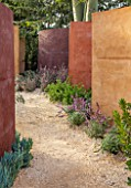 RADICEPURA GARDEN FESTIVAL, SICILY, ITALY: DESIGNER ANDY STURGEON, LAYERS, WALLS, BRACHYCHITON RUPESTRIS, QUEENSLAND BOTTLE BRUSH, GRAVEL PATHS
