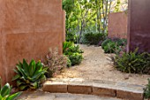 RADICEPURA GARDEN FESTIVAL, SICILY, ITALY: DESIGNER ANDY STURGEON, LAYERS, WALLS, BRACHYCHITON RUPESTRIS, QUEENSLAND BOTTLE BRUSH, GRAVEL PATHS, LEPTOSPERMUM, STONE