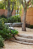 RADICEPURA GARDEN FESTIVAL, SICILY, ITALY: DESIGNER ANDY STURGEON, LAYERS, WALLS, BRACHYCHITON RUPESTRIS, QUEENSLAND BOTTLE BRUSH, GRAVEL PATHS, STONE BENCHES, SEATS