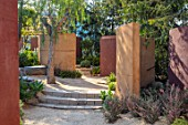 RADICEPURA GARDEN FESTIVAL, SICILY, ITALY: DESIGNER ANDY STURGEON, LAYERS, WALLS, BRACHYCHITON RUPESTRIS, QUEENSLAND BOTTLE BRUSH, GRAVEL PATHS, LEPTOSPERMUM, STONE BENCHES