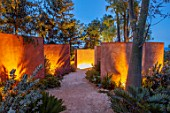 RADICEPURA GARDEN FESTIVAL, SICILY, ITALY: DESIGNER ANDY STURGEON, LAYERS, WALLS, LEPTOSPERMUM, WATER FEATURE, SPOUT, LIGHTS, LIGHTING, GRAVEL, BRACHYCHITON RUPESTRIS