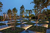 RADICEPURA GARDEN FESTIVAL, SICILY, ITALY: HOME GROUND BY ANTONIO PERAZZI. WATER GARDEN WITH TREES, WATER FEATURE, PALM TREES, LIGHTING, NIGHT, LIGHTS