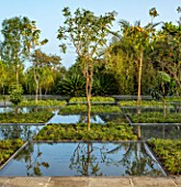 RADICEPURA GARDEN FESTIVAL, SICILY, ITALY: HOME GROUND BY ANTONIO PERAZZI. WATER GARDEN WITH TREES, WATER FEATURE