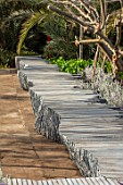 RADICEPURA GARDEN FESTIVAL, SICILY, ITALY: HOME GROUND BY ANTONIO PERAZZI. SEATING, BENCHES MADE FROM RECYCLED STONE SLABS, RECYCLING, SEATS