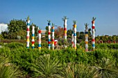 RADICEPURA GARDEN FESTIVAL, SICILY, ITALY: THE BABYLONIAN CRADLE GARDEN, COLOURFUL TOWERS TOPPED WITH AGAVES IN CONTAINERS