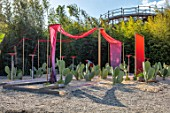 RADICEPURA GARDEN FESTIVAL, SICILY, ITALY: CARMINE CATCHER GARDEN DESIGNED BY ANNA RHODES AND CLARE FLATLEY. PRICKLY PEAR CACTUS, CERAMICS, FABRIC