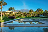 RADICEPURA GARDEN FESTIVAL, SICILY, ITALY: VIEW OF MOUNT ETNA FROM THE WATER GARDENS. PALMS, REFLECTED, REFLECTIONS