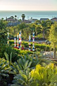 RADICEPURA GARDEN FESTIVAL, SICILY, ITALY: VIEW OVER SHOWGROUND WITH PALMS AND THE BABYLONIAN CRADLE GARDEN TO THE SEA