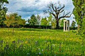 MORTON HALL, WORCESTERSHIRE: PARKLAND, MEADOW IN SPRING WITH WILDFLOWERS AND CAMASSIA LEICHTLINII CAERULEA, MONOPTEROS