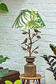 JAMIES JUNGLE, LONDON HOUSE OF JAMIE SONG: PLANT LAMPSHADE ON LAMP