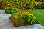 DESIGNER JAMES SCOTT, THE GARDEN COMPANY: STONE TERRACE, PATIOS, PAVED, CORTEN STEEL EDGED BEDS, AMELANCHIER X GRANDIFLORA ROBIN HILL, GEUM TOTALLY TANGERINE, LAWN