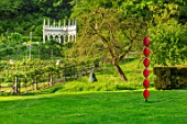 PAINSWICK ROCOCO GARDEN, GLOUCESTERSHIRE: ART UNBOUND - THE EXEDRA. LANDSCAPE, GREEN, BUILDINGS, FOLLIES, RISE 1 BY REBECCA NEWNHAM, MR PEAR BY JOE AND JENNY SMITH