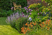 DESIGNER JAMES SCOTT, THE GARDEN COMPANY: BORDER BESIDE LAWN, GEUM TOTALLY TANGERINE, IRIS JANE PHILLIPS, ALLIUM GLADIATOR, NEPETA WLKERS LOW, BORDERS, STIPA GIGANTEA