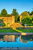 WINSON MANOR, GLOUCESTERSHIRE: SWIMMING POOL GARDEN, SUMMER, LAWN, STEPS, ALCHEMILLA MOLLIS, GATE, GATEWAY, WALLS, REFLECTIONS, REFLECTING