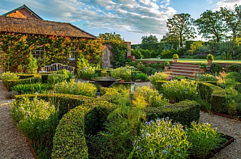 MANOR_FARM_CHESHIRE_VIEW_ONTO_FORMAL_HERB_GARDEN__STEPS_GRAVEL_WATER_FEATURE_BOX_HEDGES_HEDGING_AMSO