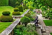 WINSON MANOR, GLOUCESTERSHIRE: LAWN, RAISED BED, YEW TOPIARY ON LAWN, CATALPA, STATUES, WALLS, SUMMER, BORDERS