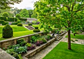WINSON MANOR, GLOUCESTERSHIRE: LAWN, YEW TOPIARY, CLIPPED, STEPS, BORDERS, RAISED BEDS, CATALPAS, SUMMER, ENGLISH, COUNTRY, GARDENS