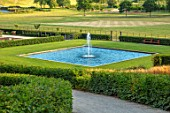 THE NEWT IN SOMERSET: VIEW TO BATHING POND, FOUNTAIN, HORNBEAM HEDGES, JULY, ENGLISH, COUNTRY, GARDENS