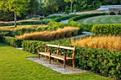 THE NEWT IN SOMERSET: LAWN, SEAT, SEATING, GRASSES, HORNBEAM HEDGES, HEDGING, JULY, ENGLISH, COUNTRY, GARDEN