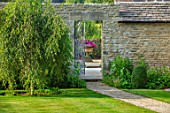 ADAMS POOL, GLOUCESTERSHIRE: GRAVEL PATH, LAWN, METAL GATE, WALL, WILLOW TREE