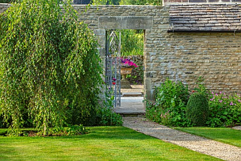 ADAMS_POOL_GLOUCESTERSHIRE_GRAVEL_PATH_LAWN_METAL_GATE_WALL_WILLOW_TREE