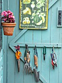 ADAMS POOL, GLOUCESTERSHIRE: BLUE SHED DOOR WITH TOOLS
