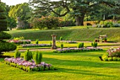 CANONS ASHBY, NORTHAMPTONSHIRE, THE NATIONAL TRUST - LAWNS, SUNDIAL, CEDAR OF LEBANON, BEDDING, BEDS, EVENING, JULY