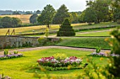 CANONS ASHBY, NORTHAMPTONSHIRE, THE NATIONAL TRUST - LAWNS, SUNDIAL, CEDAR OF LEBANON, BEDDING, BEDS, EVENING, JULY, SLOPES, CLIPPED, TOPIARY, YEW, BORROWED LANDSCAPE