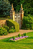CANONS ASHBY, NORTHAMPTONSHIRE, THE NATIONAL TRUST - WALL, GATE, LAWN, BEDDING, BEDS, EVENING, JULY, ENGLISH, COUNTRY, GARDEN