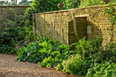 CANONS ASHBY, NORTHAMPTONSHIRE, THE NATIONAL TRUST - WALL, GATE, ACANTHUS SPINOSUS, JULY, SUNSET, GRAVEL, PATH